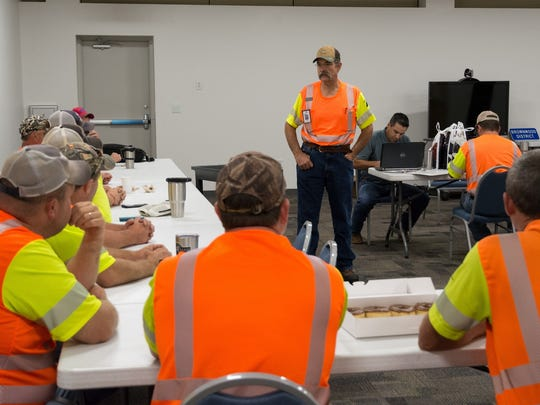 Texas Department of Transportation Brownwood District workers hold a safety meeting before being deployed to help with disaster response in South Texas.
