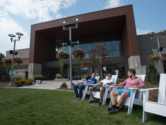 University of Wyoming students visiting for the day, from left, Connor Magnuson, Mannan Qazi, and Maurice Kees, lounge on the lawn on the East side of the Foothills Mall, Tuesday, August 29, 2017, in Fort Collins, Colo.