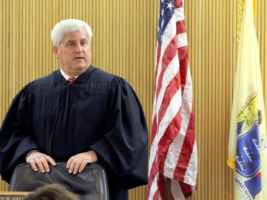 Superior Court Judge Joseph W. Oxley addresses the