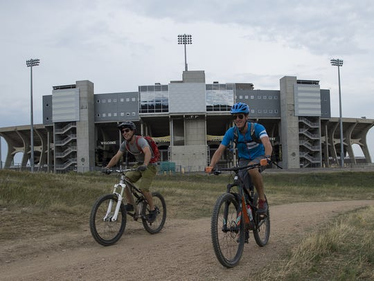 Cyclists make their way North on the Foothills Trail