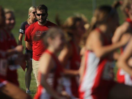 City High co-head coach Ryan Ahlers watches runners