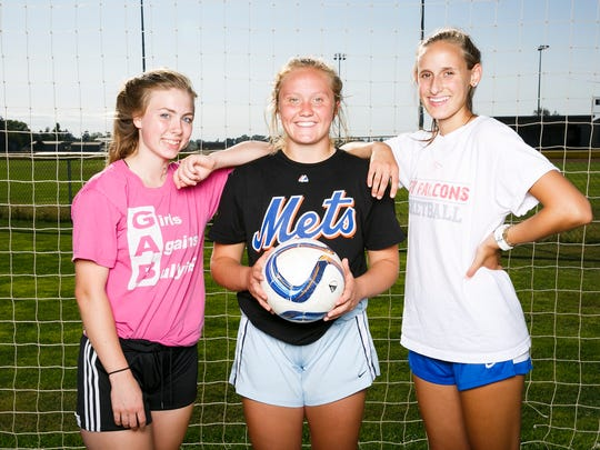 (Left to right) Silverton High School soccer captains Brylee Mead, Maggie Roth and Savannah Reilly at a practice on Wednesday, Aug. 30, 2017, in Silverton, Ore.