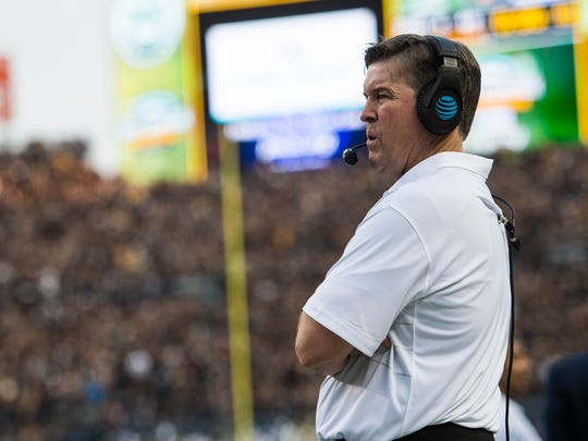 CU head coach Mike MacIntyre patrols the sidelines,