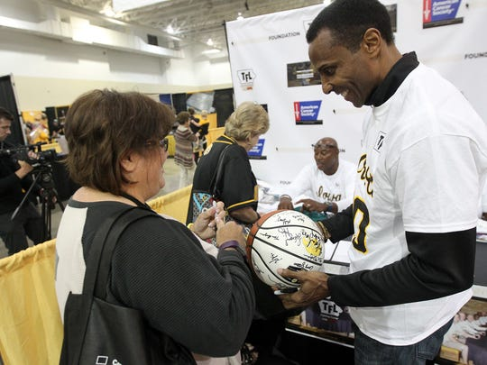 Ronnie Lester signs an autograph for Rhonda Evans of Tiffin before he and other members of the 1980 Final Four team are recognized at FRYfest at the Coralville Marriott on Friday, Sept. 1, 2017.