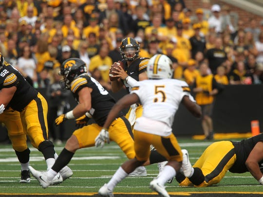 Iowa quarterback Nate Stanley looks for an open receiver during his starting debut against Wyoming at Kinnick Stadium on Saturday. The sophomore threw for three touchdowns in a 24-3 win.