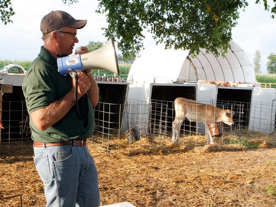 In this file photo Tom Oberhaus, owner of Cozy Nook Farm in Waukesha County, talks about raising calves during a Professional Dairy Producers (PDPW) ACE Twilight meeting on Aug. 30, 2017.