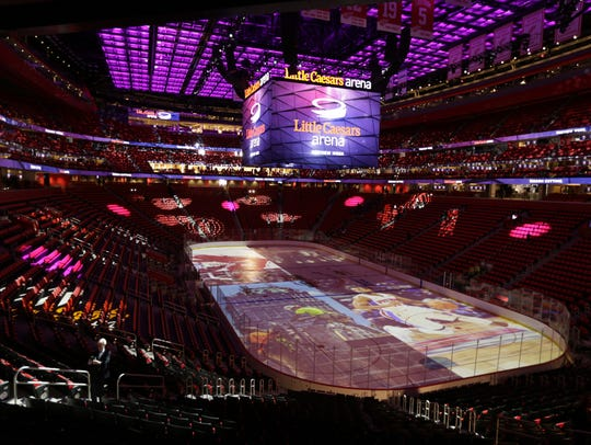 The inside of Little Caesars Arena after a ribbon-