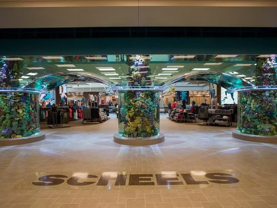 The front entrance of the store is decorated with a massive saltwater fish tank.