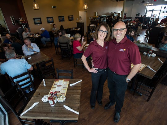 Husband and wife co-owners David Glista and Lisa Boesch pose for a portrait, Thursday, Sept. 7, 2017, at the soft-opening for the Famous Toastery on East Harmony Road in Fort Collins, Colo.