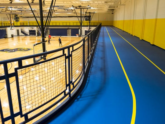 A newly installed track circles the Fieldhouse above the basketball courts at SC4. A partnership between SC4 and the YMCA will open the Fieldhouse to the public for new fitness classes.