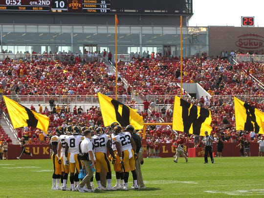 Iowa teammates huddle up following a touchdown during their game against Iowa State at Jack Trice Stadium in Ames on Saturday, Sept. 9, 2017.