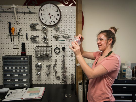 Senior food science and nutrition major Kinsey Riley checks the pH on the wort from a batch there class is brewing, Friday, Sept. 8, 2017, during a Brewing Science and Technology class at Colorado State University in Fort Collins, Colo.