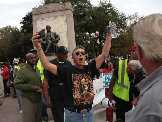 Counterprotester Sam Lipari of South Warren stands