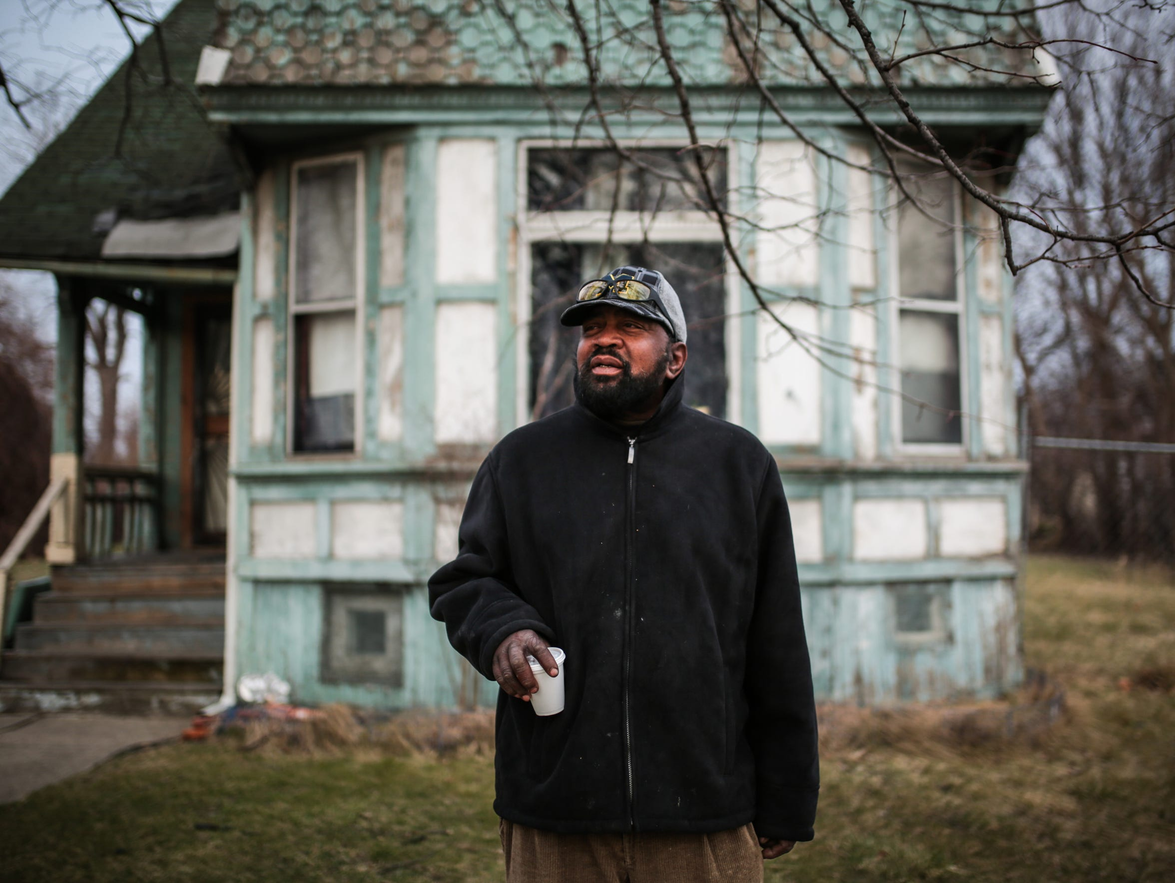 Darnell Taylor, 63, of Detroit stands near the Salvation