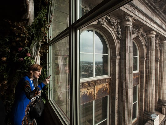 Lisa Pollina of Chicago looks out at the view of Detroit from the 13th floor of Michigan Central Station in Detroit on Sept.r 13, 2017, during Crain's Detroit Homecoming IV event.