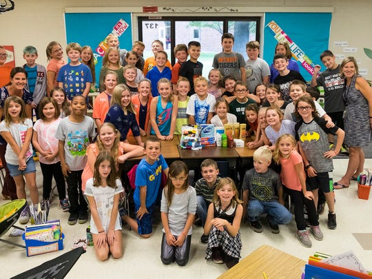Students in Shelly Kiteley and Sarah Discoll's fourth grade classes at Keewahdin Elementary School with supplies they've gathered to send to schools in Houston, Texas, Sept. 13.