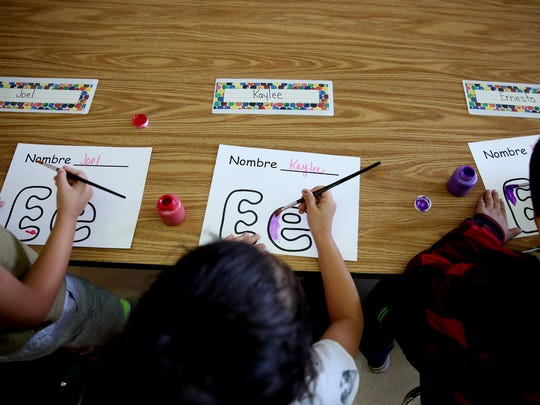 Kindergarteners paint letters at Chávez Elementary School in Salem on Wednesday, Sept. 13, 2017.