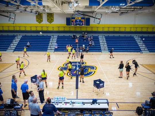 The SC4 Skippers and the Oakland Community College Raiders warm up before the first volleyball game in the completed SC4 field house Sept. 14, 2017.