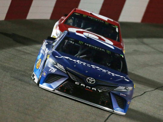 Martin Truex Jr. (foreground) -- shown leading Kyle Larson at Richmond -- also leads Larson in the Monster Energy NASCAR Cup standings heading into the playoffs, although both have four victories  this season.