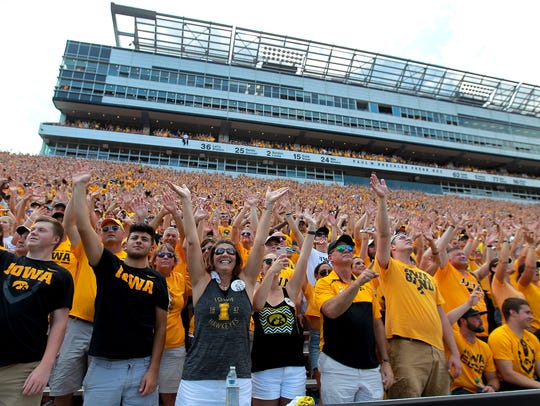 Iowa fans wave to children at the University of Iowa