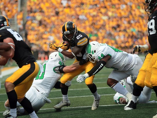 Iowa running back Akrum Wadley fights his way down field during the Hawkeyes' game against North Texas at Kinnick Stadium on Saturday, Sept. 16, 2017.