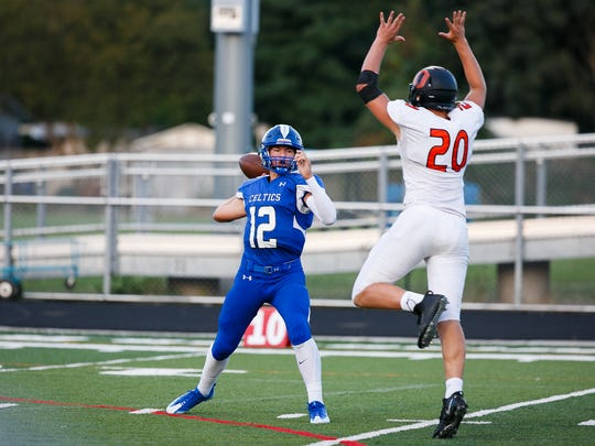 Sprague's Teagan Quitoriano (20) leaps to knock down Erik Barker's (12) first throw in a game on Friday, Sept. 15, 2017, at McNary High School in Keizer, Ore. Sprague defeated McNary 62-6.