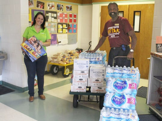 Brittany Bearden of Waste Management delivers food