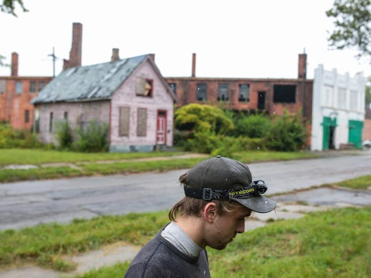 Detroit artist Pat Perry poses for a photo in his neighborhood