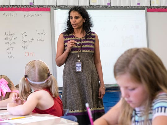 Washington Elementary School first grade teacher Manjana Karnan teaches her class about letters Sept. 21. When including days spent in professional development, the Marysville Public Schools District has the highest percentage of absent teachers.