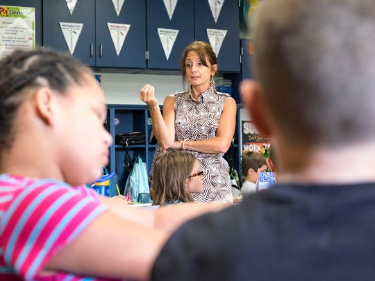 Washington Elementary School teacher Rose Chrcek teaches her third graders about proper nouns Sept. 21. When including days spent in professional development, the Marysville Public Schools District has the highest percentage of absent teachers.