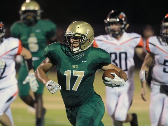 Iowa City West's Jalen Gaudet, pictured here in a game last year against Cedar Rapids Prairie, had a big game for the Trojans last Friday. His efforts helped Iowa City West break into the Des Moines Register's High School Football Super 10 Rankings in Week Two.