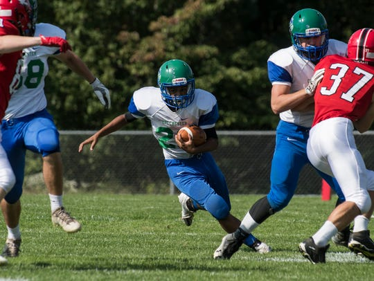 Colchester's Quentin Hoskins (28) runs with the ball