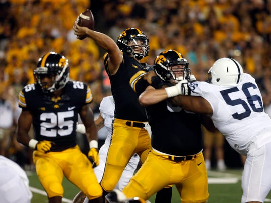 Iowa quarterback Nate Stanley throws down field during the Hawkeyes' game against No. 4 Penn State at Kinnick Stadium on Saturday, Sept. 23, 2017.