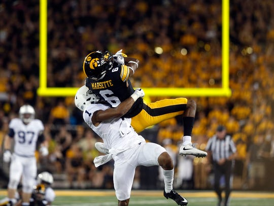 Iowa wide receiver Ihmir Smith-Marsette pulls in a