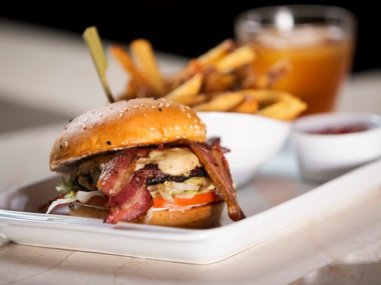 The Prime Degree burger, featuring St. Elmo Steak House dry-aged beef topped with applewood smoked bacon, served at Burger Study, an upscale restaurant and bar attached to Circle Centre in Downtown Indianapolis, seen Friday, Sept. 22, 2017.