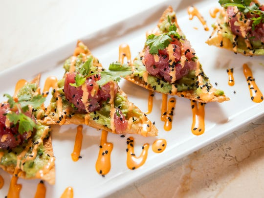 Ahi tuna and avocado on wontons at Burger Study from the owners of St. Elmo Steak House. They had planned Burger Study for The Yard at Fishers District, but in early 2019 unveiled plans for a new concept named HC Tavern + Kitchen. Restaurants at The Yard begin opening in fall 2019.