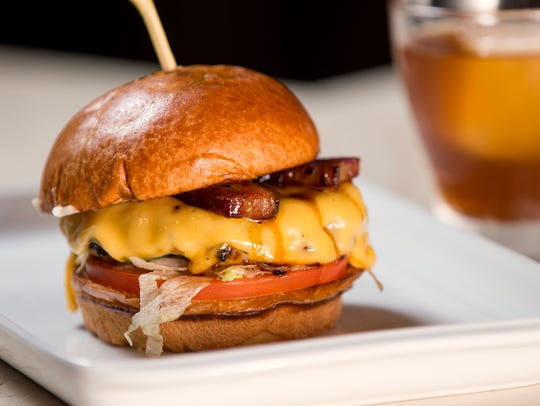 "The ""Homecoming"" burger is topped with thick-cut, root"