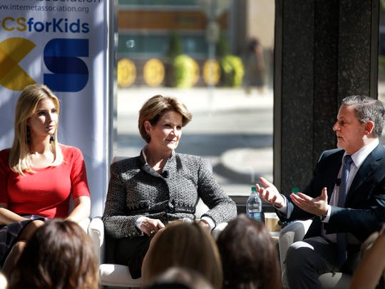 Ivanka Trump, White House, Assistant to the President, left, and Marillyn Hewson, Chairwoman, President and Chief Executive Officer, Lockheed Martin listen as Dan Gilbert, Chairman, Quicken Loans is joined by a panel to discuss STEM education, a day after President Trump issues a memo that is aimed at making STEM a priority in the U.S. Department of Education, in part by ensuring funds are available Tuesday Sep. 26, 2017 at Detroit Design 139 in Detroit.