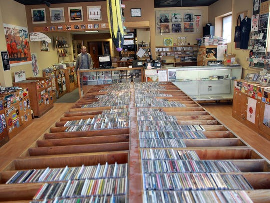Kirk Walther walks through Record Collector on Tuesday,