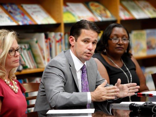 Acting JCPS superintendent Marty Pollio, center, addresses
