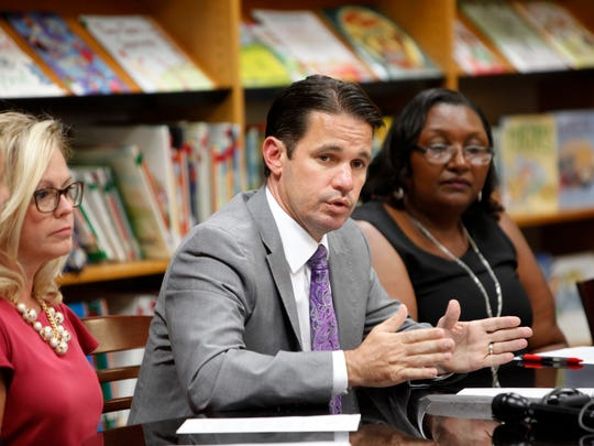 Acting JCPS superintendent Marty Pollio, center, addresses