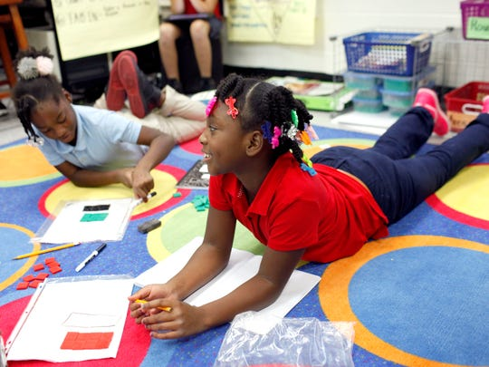 Third graders Janiyah Brown, right, and Christina Moore, both 8, work on measuring the area of a shape while in class at Portland Elementary School. Sept. 27, 2017