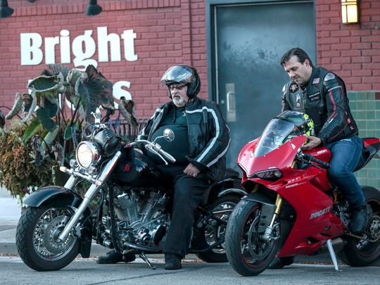 Gordon Deutch of Southfield, left, on his 2000 Yamaha parks next to David Smith of Grosse Pointe Woods on his 2015 Ducati 1299 Pantigale near South Main Street in downtown Royal Oak, Thursday, September 28, 2017.