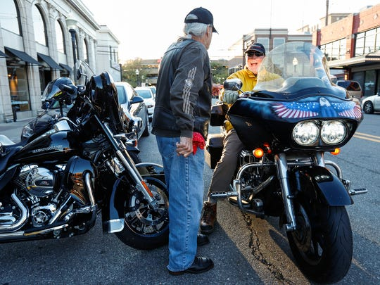 Ken Gimpert of Grosse Pointe Farms, left, speaks with Ron Korman of Birmingham who rides a 2007 Harley-Davidson Road Glide during a gathering near South Main Street in downtown Royal Oak, Thursday, September 28, 2017.