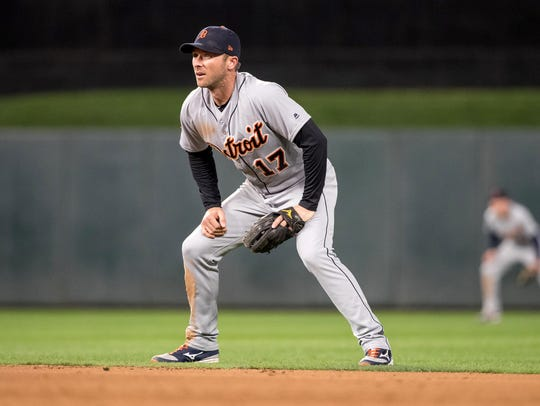 Tigers second baseman Andrew Romine (17) looks on during