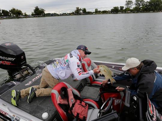 Chad Morgenthaler, left and Kevin Schleeter unload