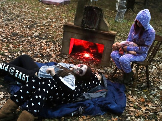 Kettle Moraine Global students wait to scare visitors during a previous Fright Hike at Lapham Peak State Park. Volunteer groups put on scary skits along the trail during the annual event. This year's event is planned for 6 to 8:30 p.m. Oct. 20 and 21.