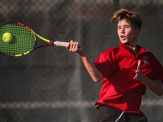 North Central Panther Ian Brady returns the ball to North Central opponent Cade Satz during IHSAA boys' regional finals at North Central High School, Indianapolis, Wednesday, Oct. 4, 2017. Brady won the match. North Central took the regional title.