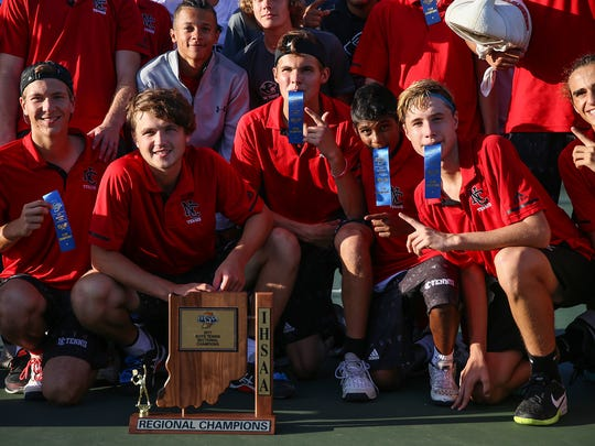 The North Central Panthers celebrate winning the IHSAA regional tennis championship over Lawrence North, at North Central High School, Indianapolis, Wednesday, Oct. 4, 2017.