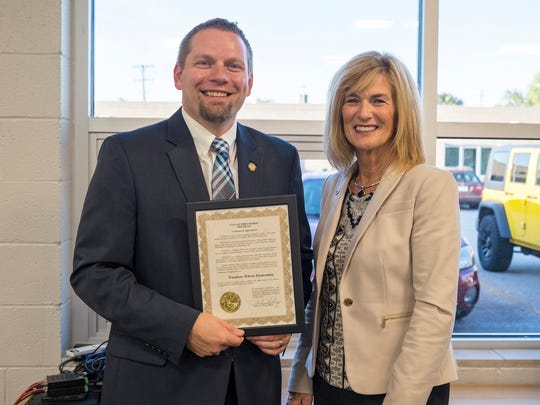 Port Huron Mayor Pauline Repp, right, presented a certificate of appreciation to Woodrow Wilson principal Joe Kramer at the open house and ribbon cutting for the learning commons at Woodrow Wilson Elementary Oct. 3. The new learning commons, which were constructed as part of the renovations area schools underwent this summer, offer space for collaborative work between students.
